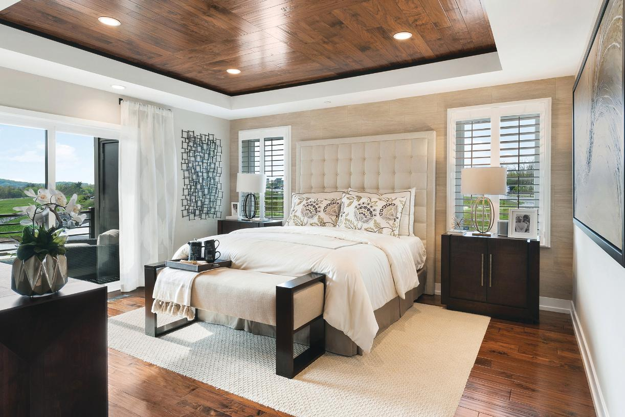 Serene primary bedroom suite with private balcony