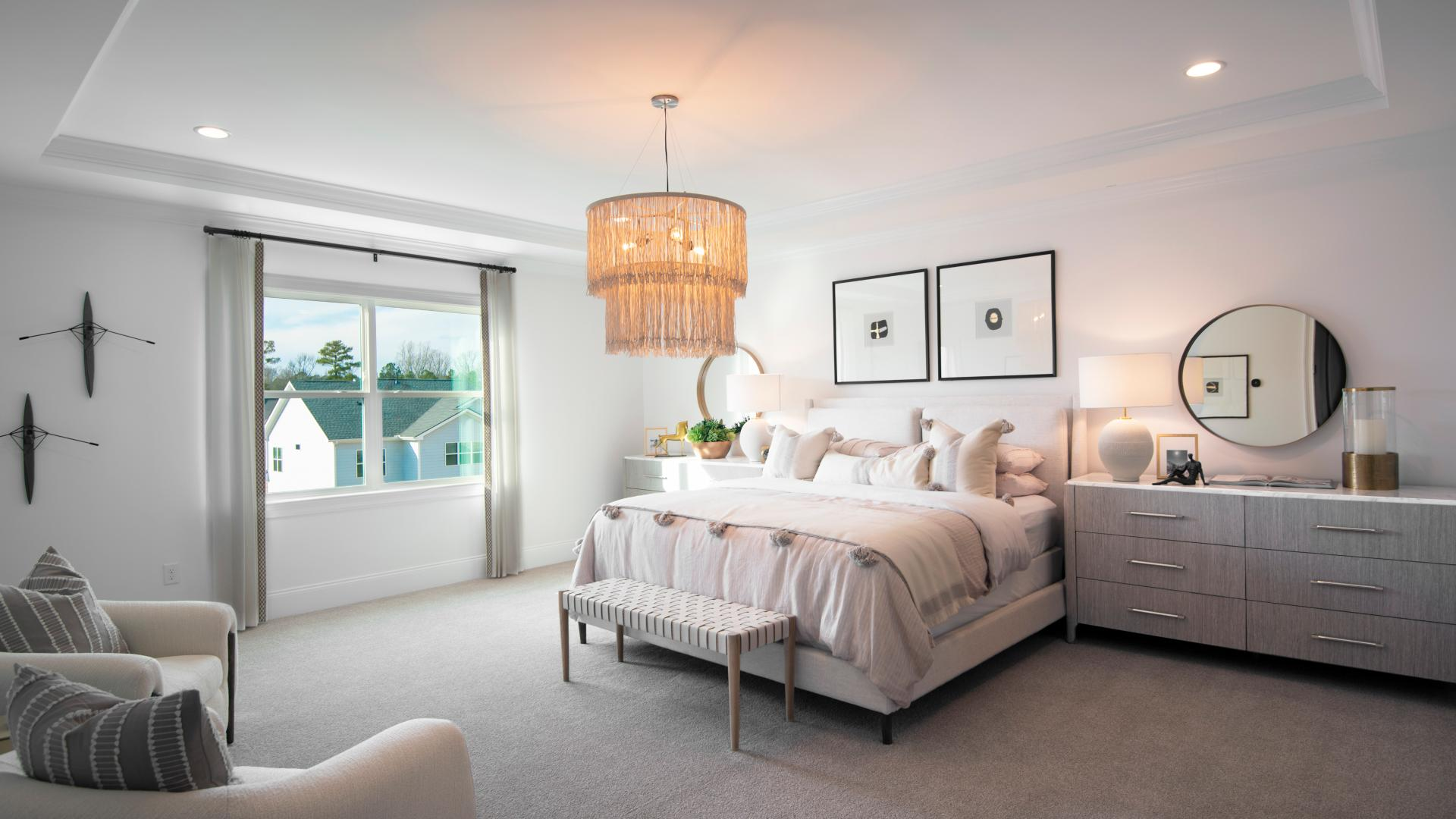 Primary bedroom suite with spacious walk-in closet and luxe primary bathroom