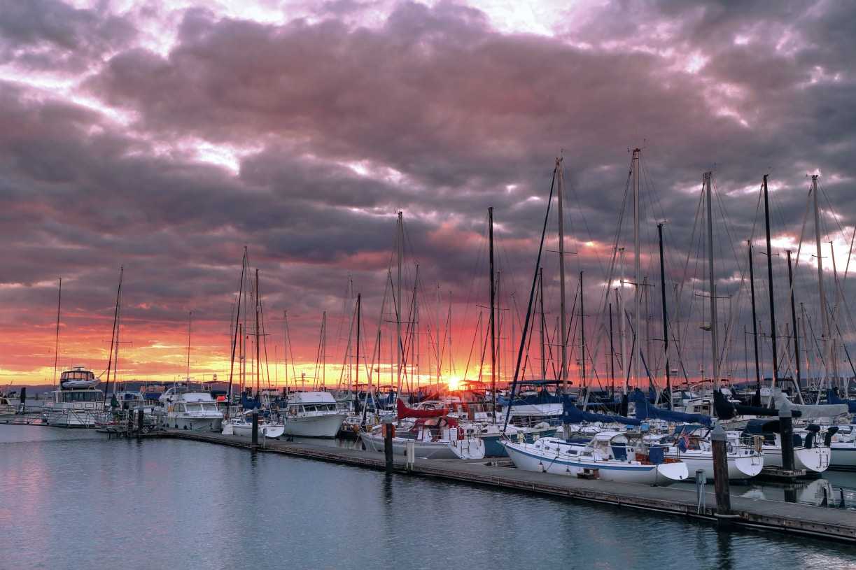 At the Everett Marina and waterfront, experience stunning sunsets, a variety of dining, and easy access to water activities on Puget Sound