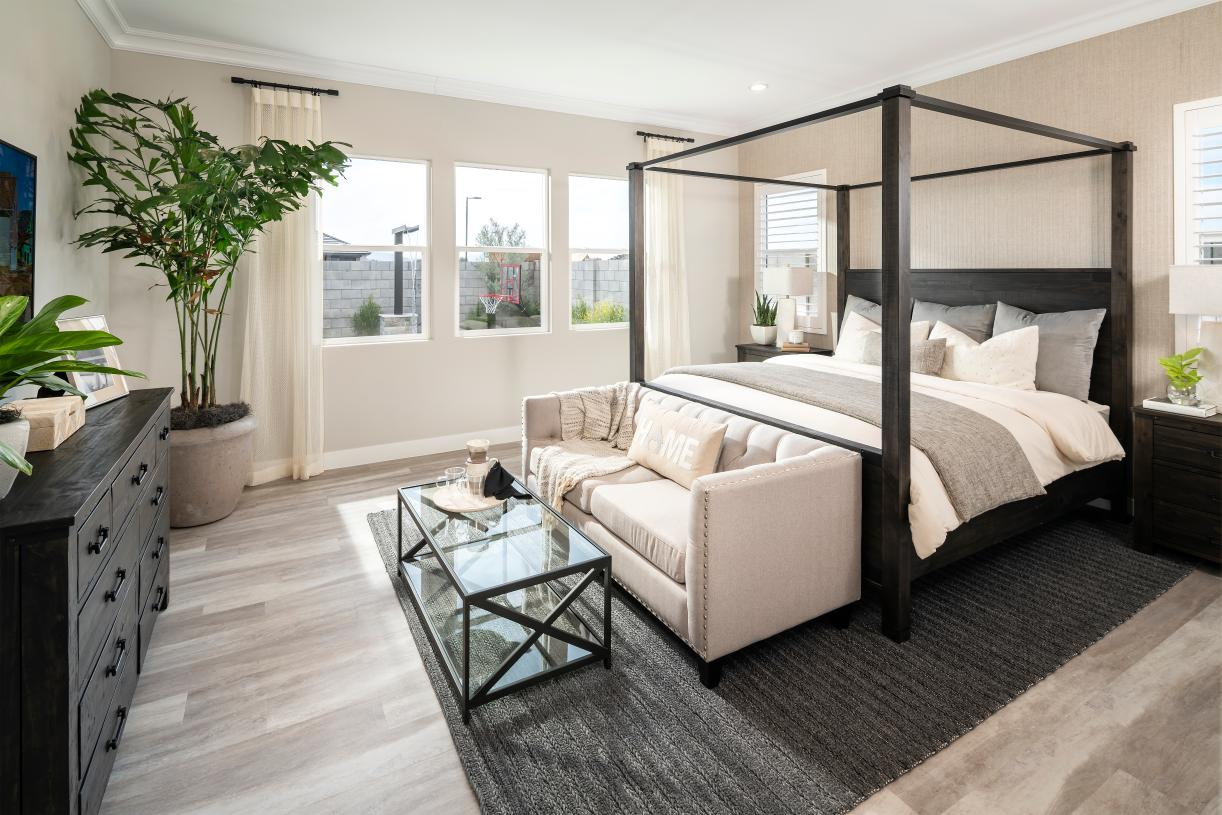 Beautiful primary bedroom suites with a sitting area and ample natural light