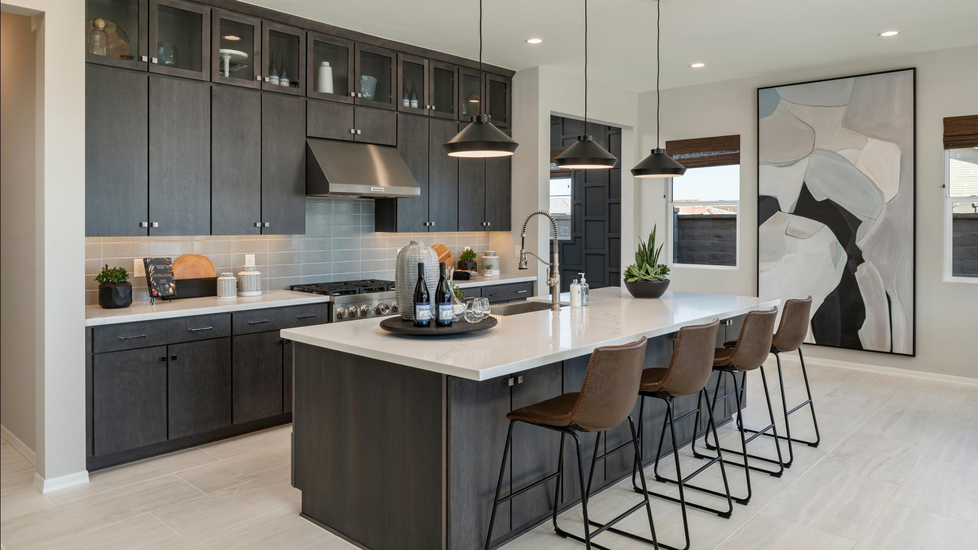 Well-designed kitchens with large center island, breakfast bar, and sizeable pantry