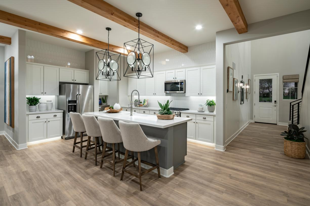 Luxurious kitchens with large center islands, ample countertop, and cabinet space