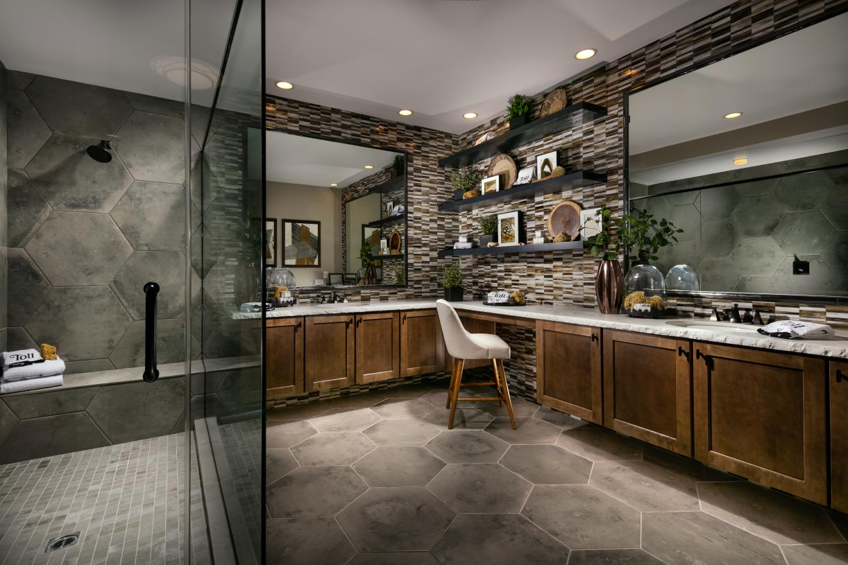 Luxurious primary baths with large walk-in showers