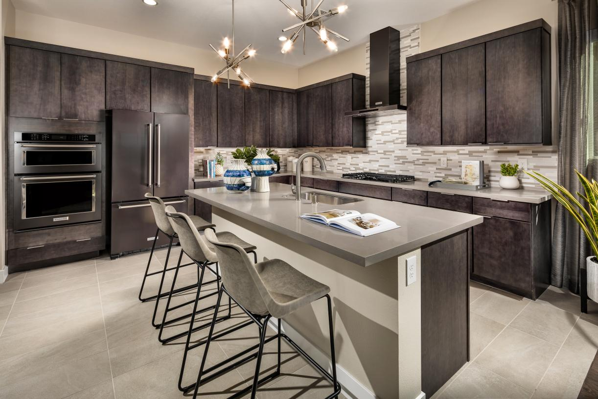Gourmet kitchens with plentiful cabinets, countertops and center islands