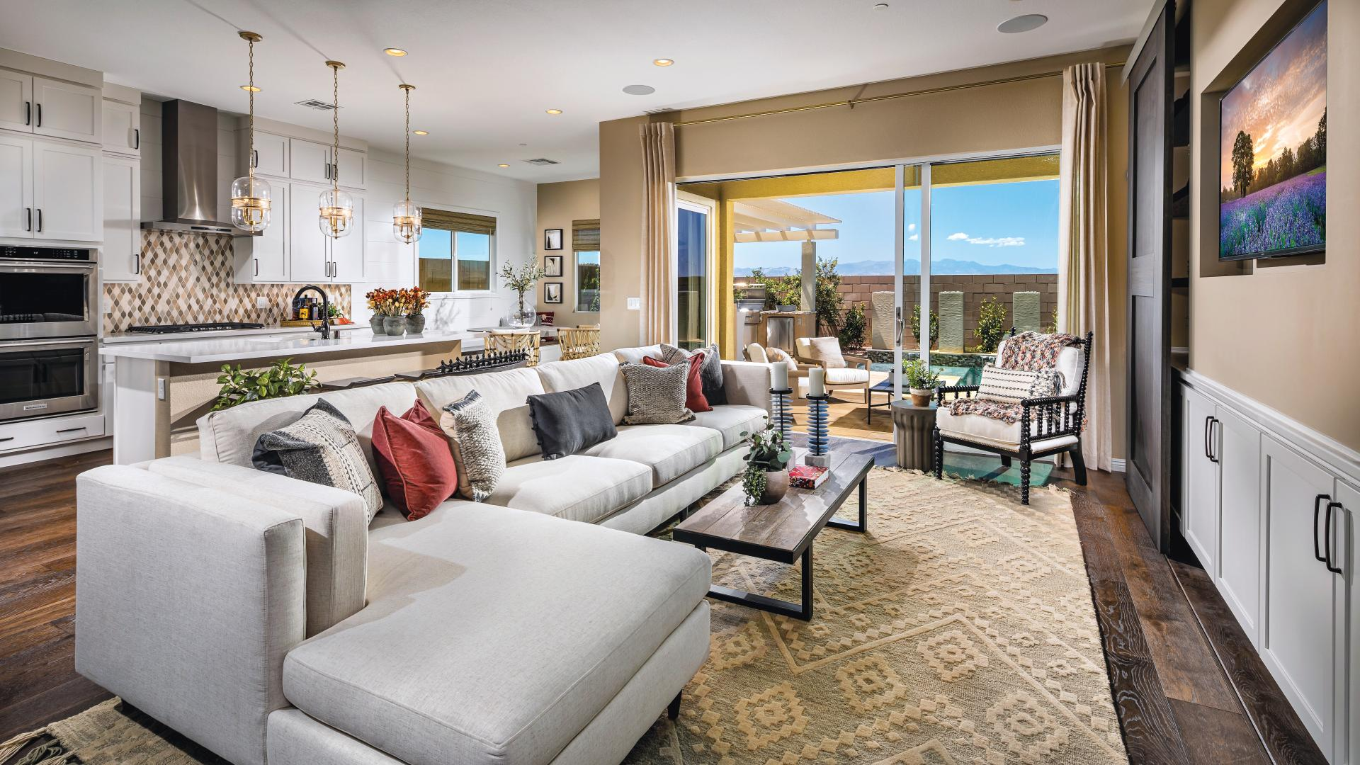 Great room opens to covered patio for ideal indoor/outdoor living