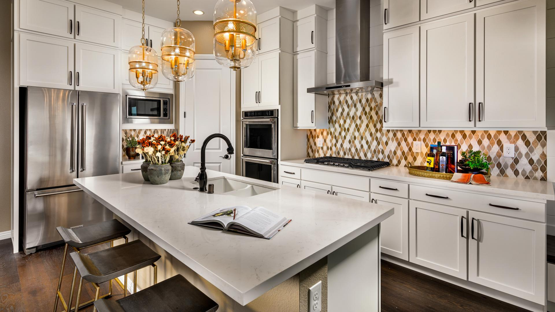 Ample counterspace and center island in this gourmet kitchen