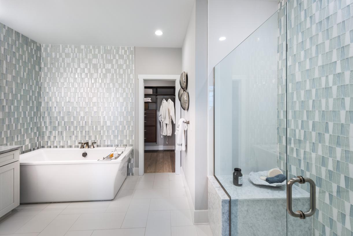 Graphic depiction: Spacious primary bathroom suites with soaking tubs and tiled showers