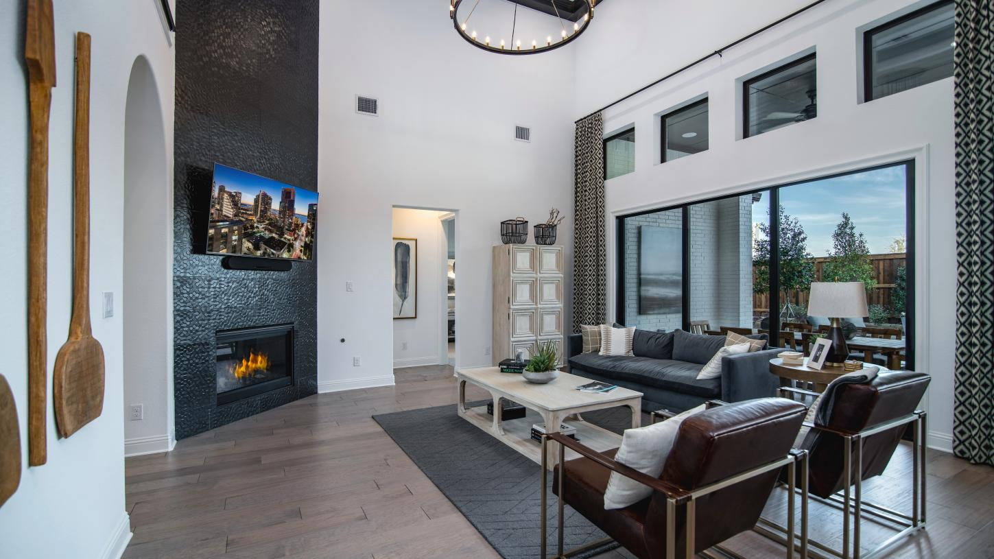 Impressive two-story Lindale great room boasts a radiant corner fireplace