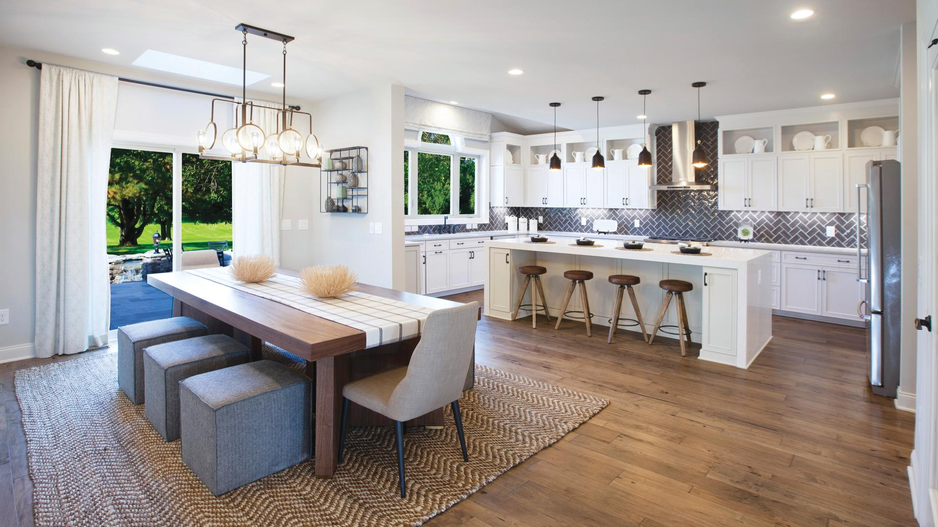 Kitchen with state-of-the-art appliances, designer finishes, and hardwood flooring