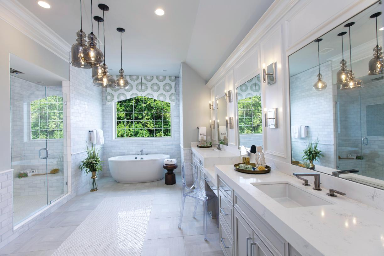 Primary bath with dual vanity, stand alone tub, and large shower