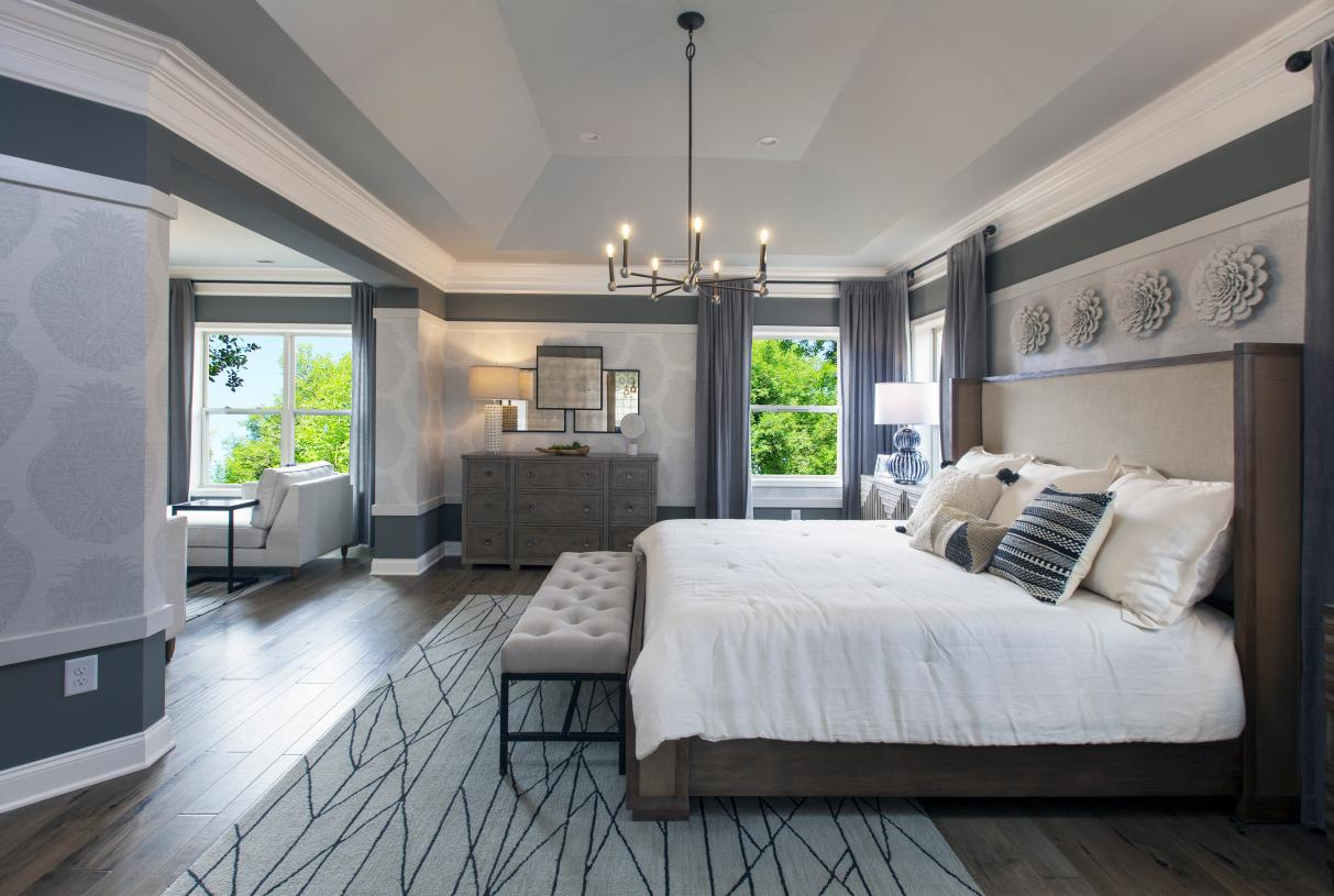 Primary bedroom suite with sitting area, walk in closet and luxurious bath