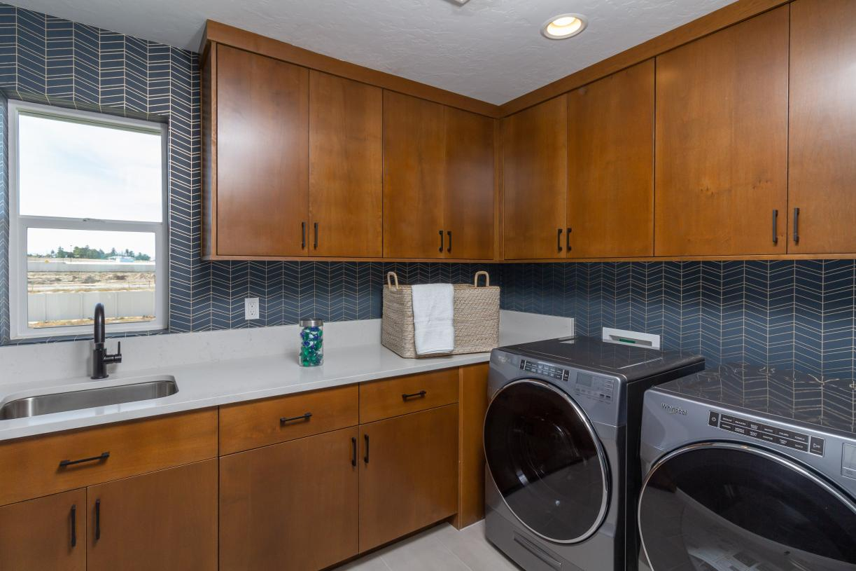 Dedicated laundry rooms with sink and cabinet options