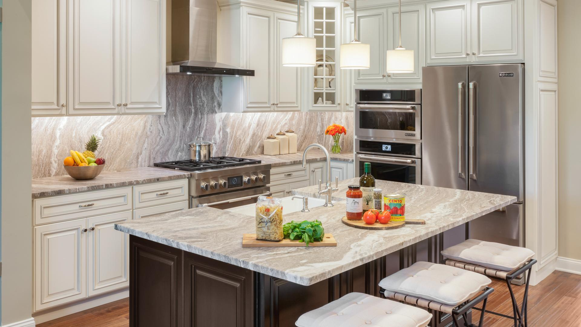 Photos are images only and should not be relied upon to confirm applicable features - Kitchen with beautiful cabinetry and marble countertops