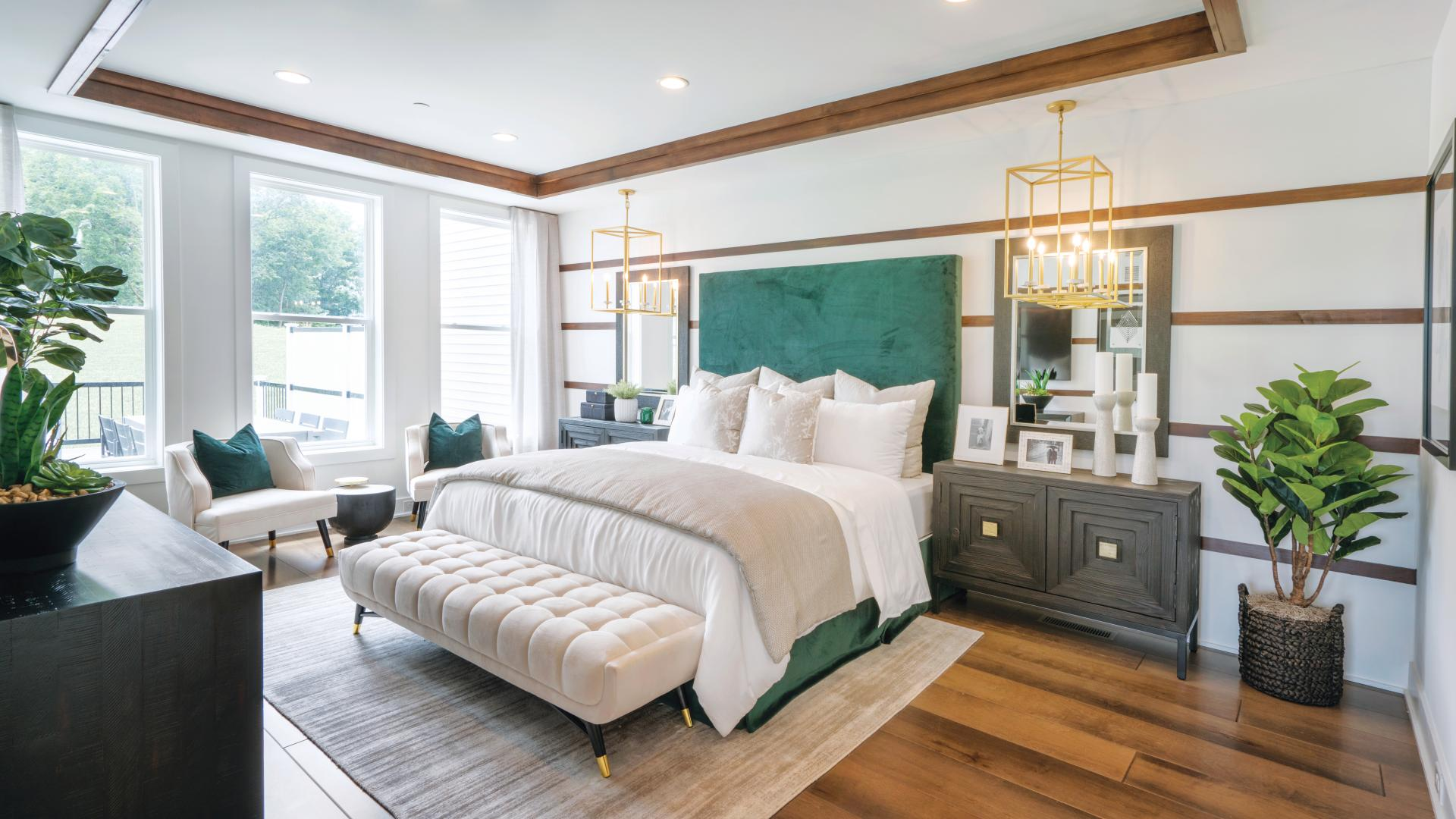Photos are images only and should not be relied upon to confirm applicable features - Primary bedroom suite with stunning light fixtures