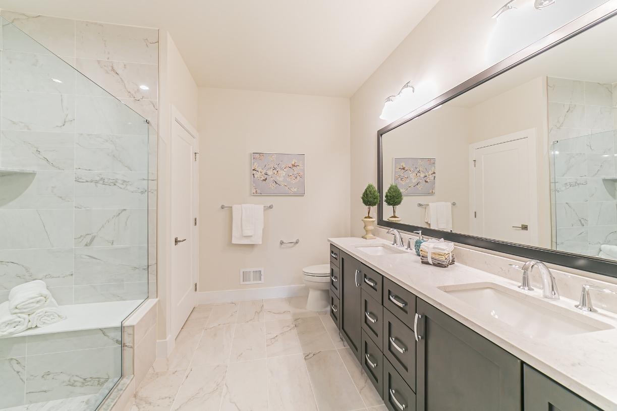 Photos are images only and should not be relied upon to confirm applicable features - A relaxing and spacious primary bath has an oversized shower