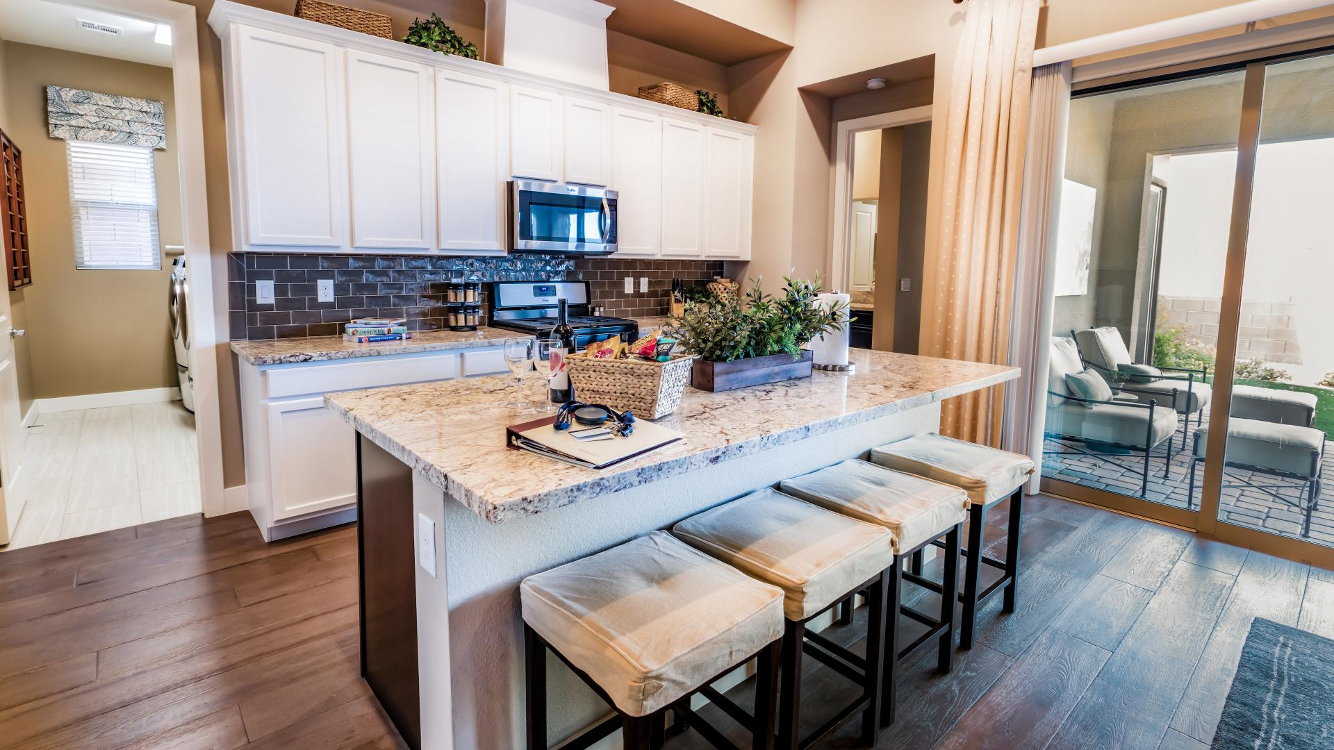 The kitchen offers expansive cabinet and counter space