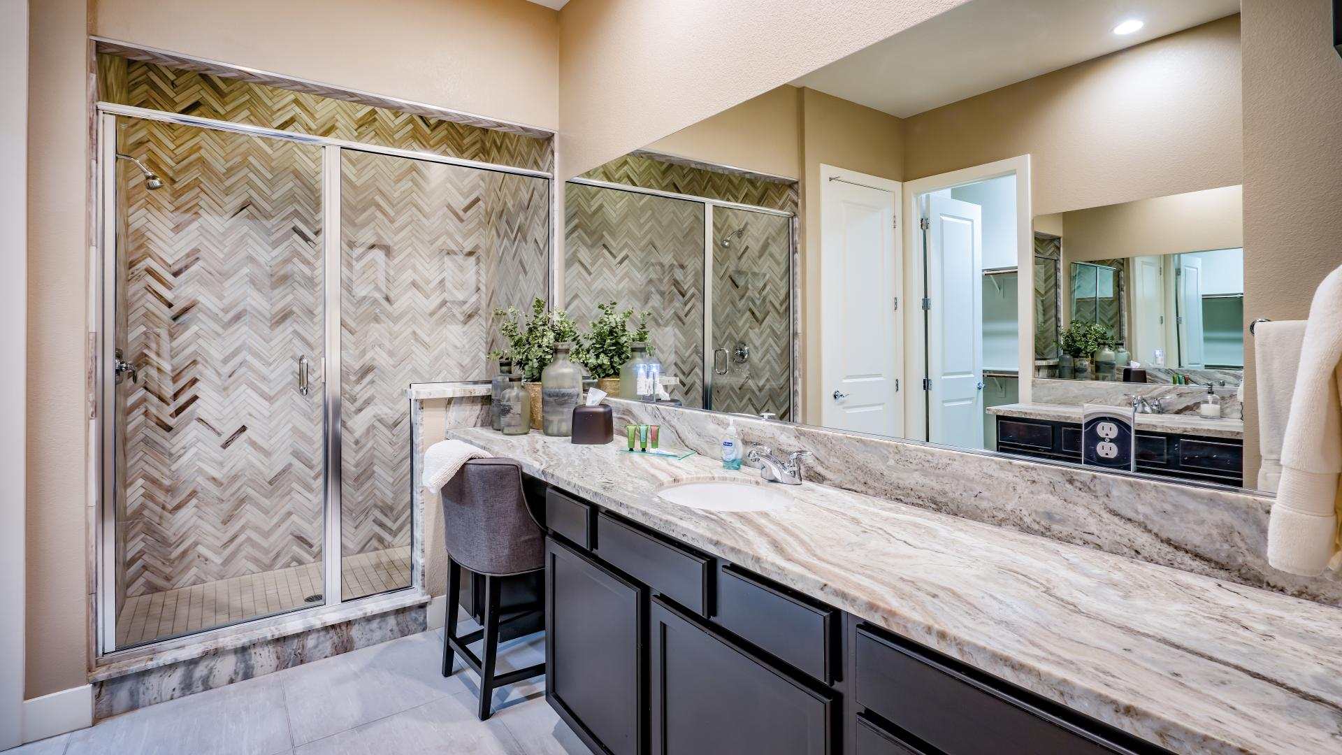 Luxe primary bathroom with large walk-in shower