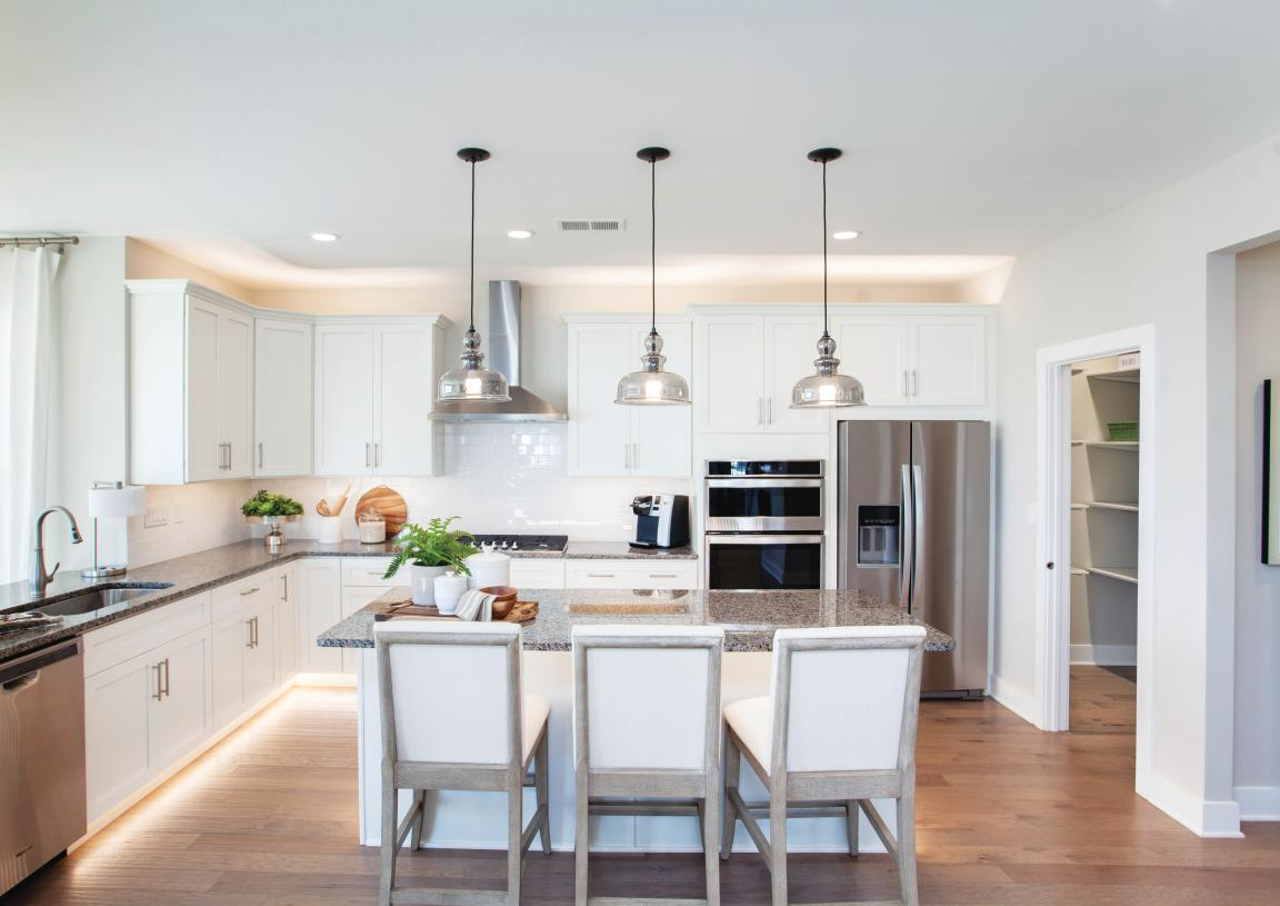 Luxurious kitchens with ample storage and brand name appliances