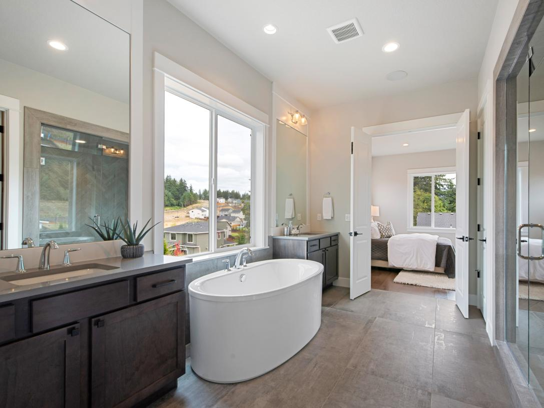 Luxe 5-piece bathroom with separate vanities and large walk-in shower