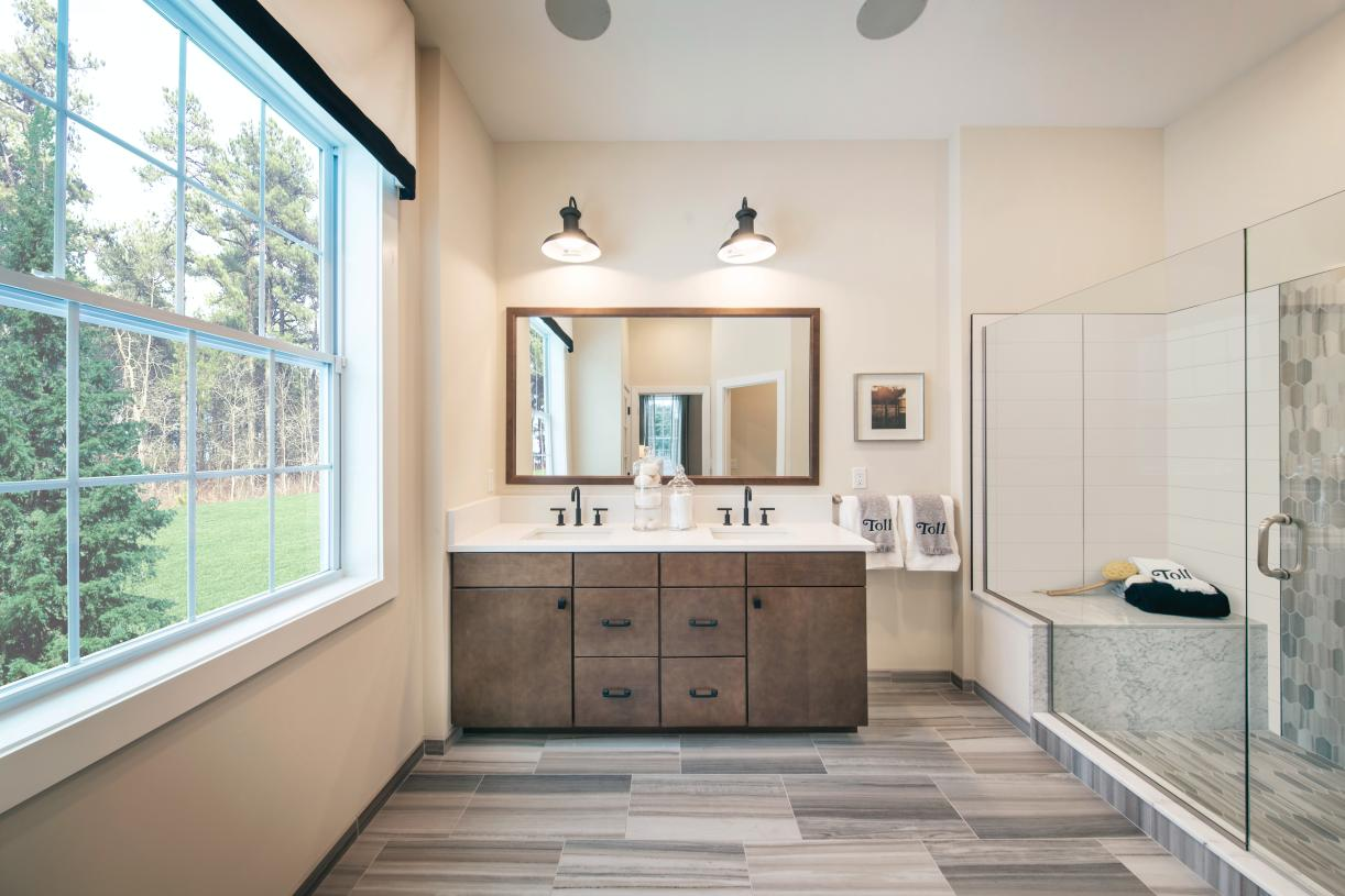 Primary bath with dual-vanity sink and spacious shower