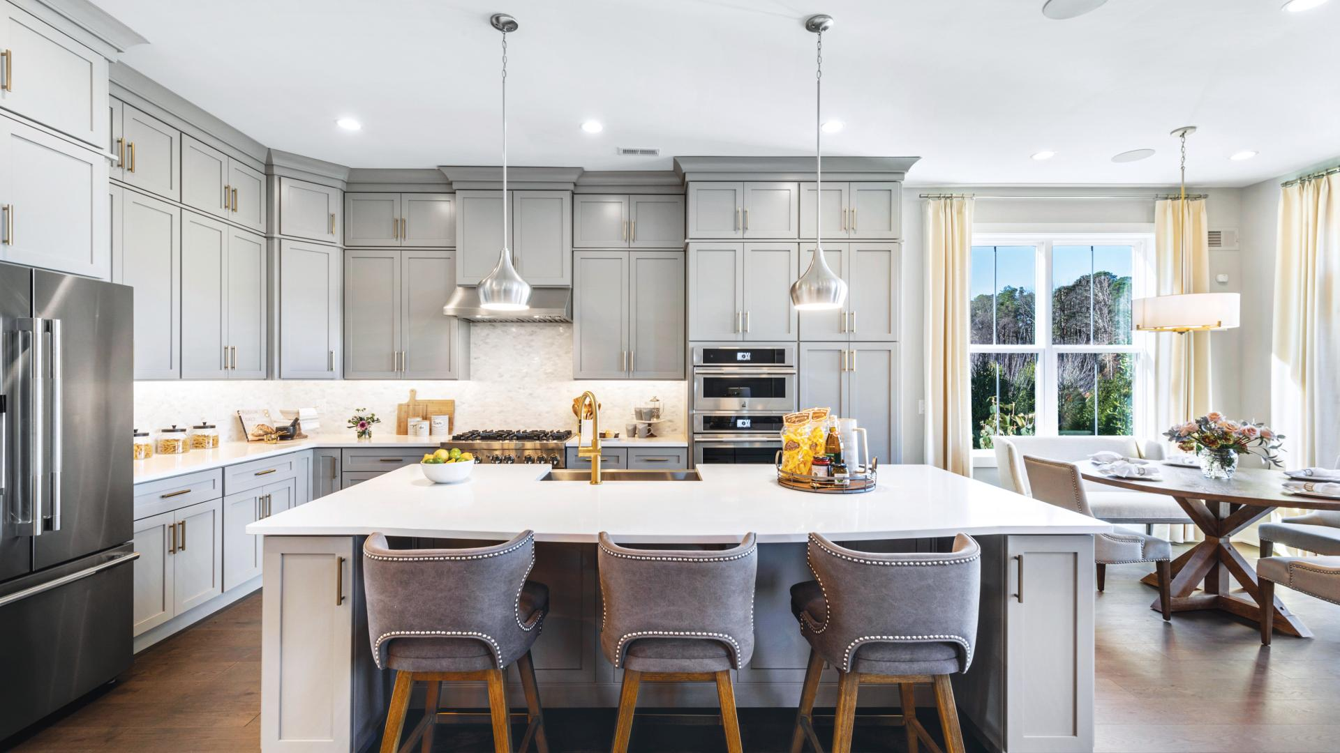 Spacious kitchens with granite countertops and luxury cabinetry