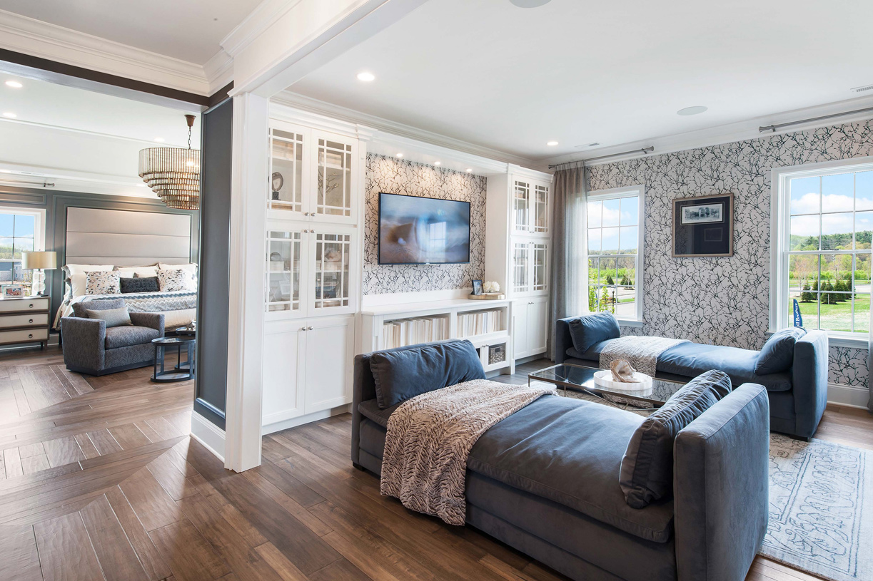 Luxurious primary bedroom suites include private retreats