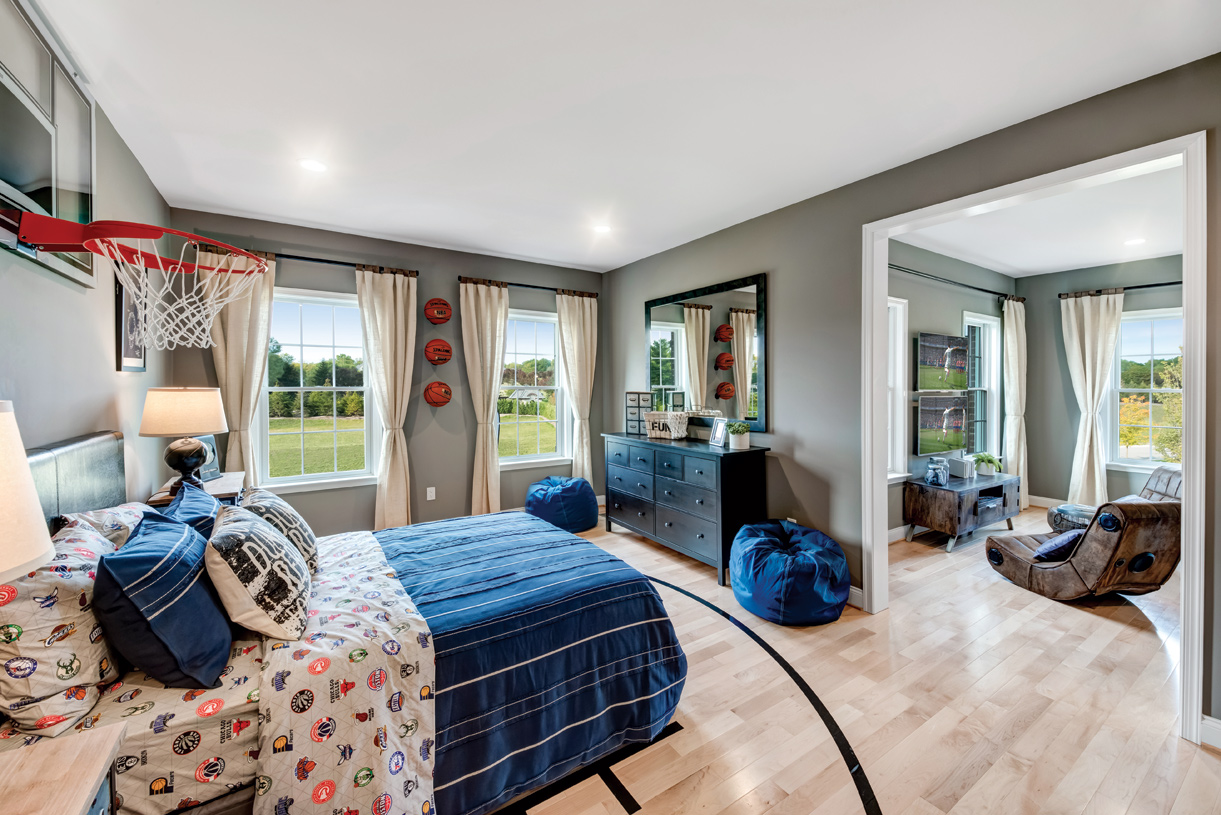 Secondary bedrooms with walk-in closets and private bathroom suites