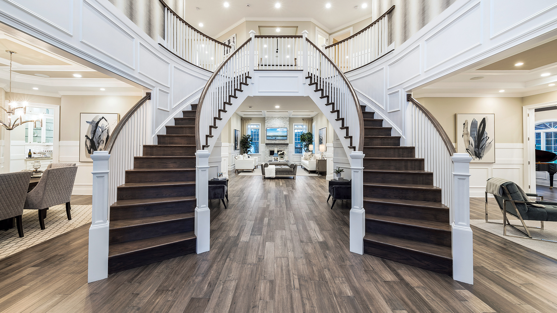 Impressive two-story foyers welcome guests