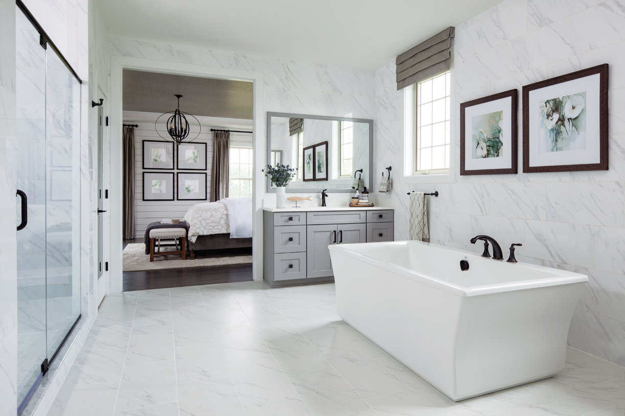Lavish primary baths boast dual vanity sinks, free standing tubs, ultra showers, and more