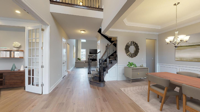 Elegant entry foyer opens to formal dining room