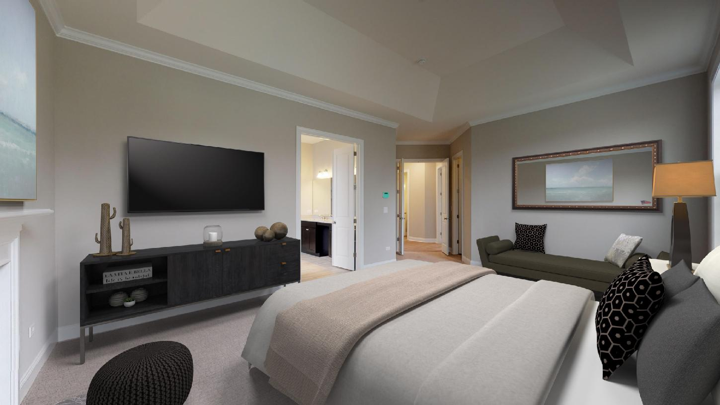 Luxurious primary bedroom suite with two large walk-in closets and lavish bath