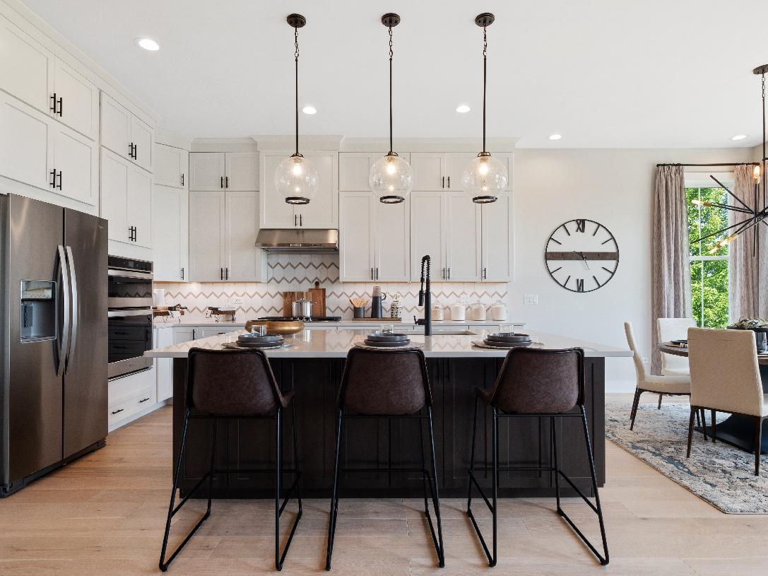 """Gourmet kitchens with Whirlpool® stainless steel appliances, luxury vinyl plank flooring, 42"""" Timberlake cabinets, granite countertops, and more"""
