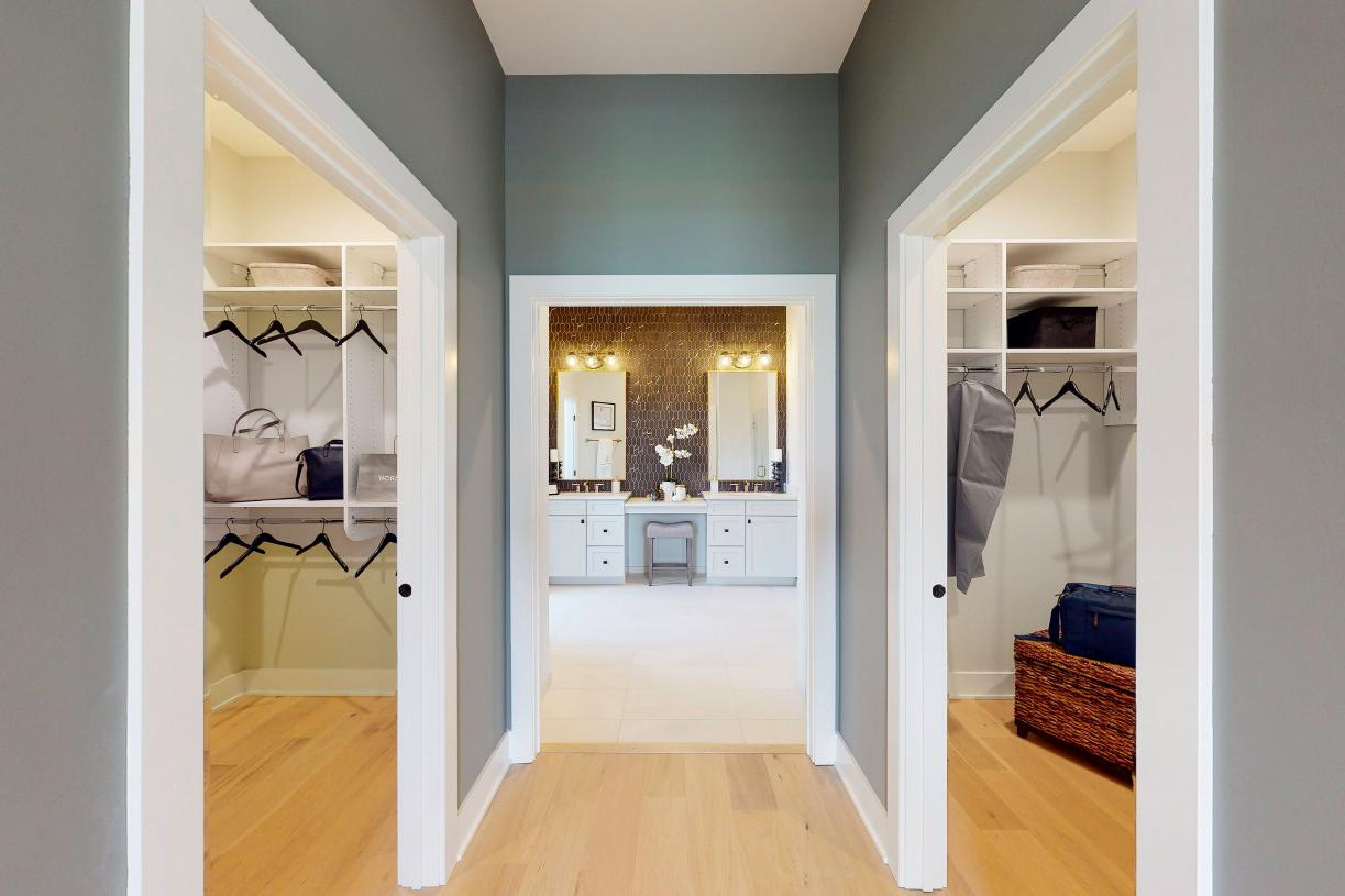 Primary bedroom hall with two large walk-in closets