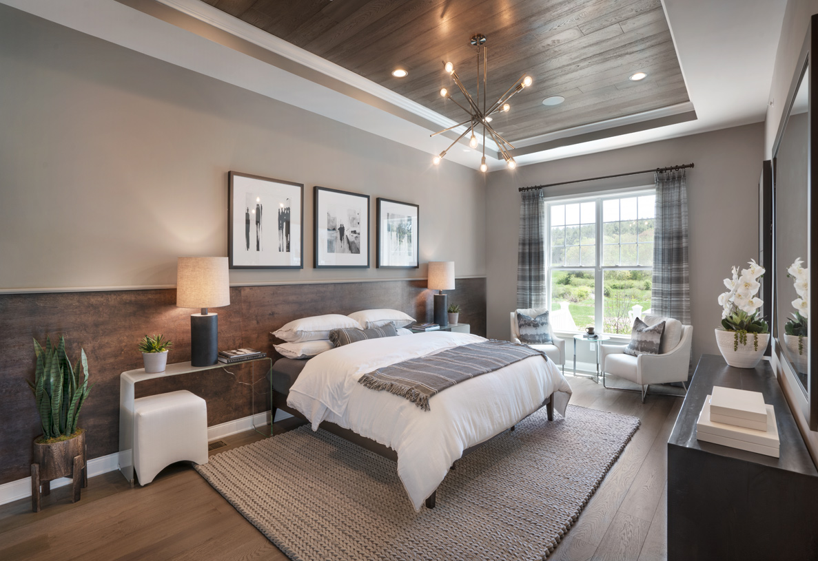Primary bedroom featuring a luxurious seating area