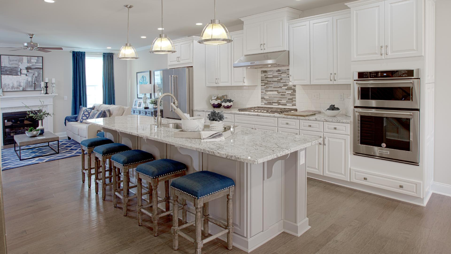 The stylish kitchen features name-brand appliances and granite countertops