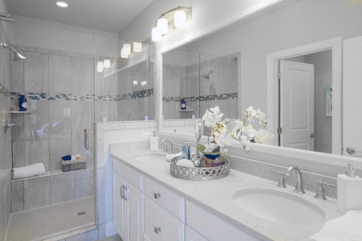 The appealing primary bathroom boasts dual sinks and granite countertops