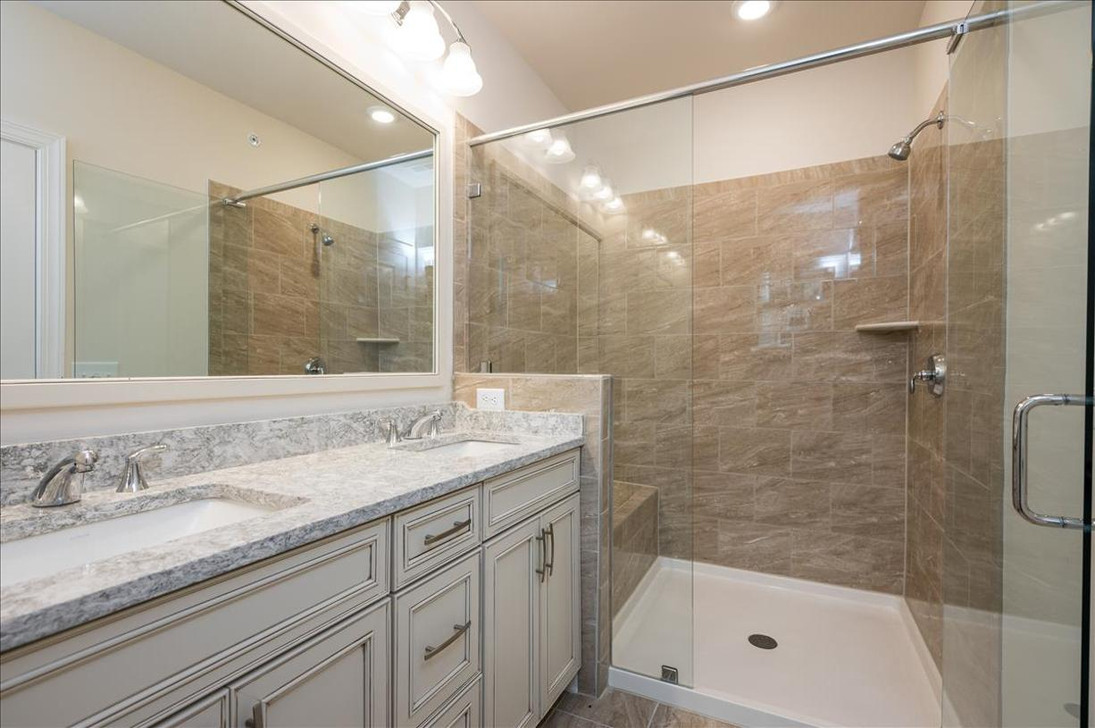Luxurious primary bath with high end finishes