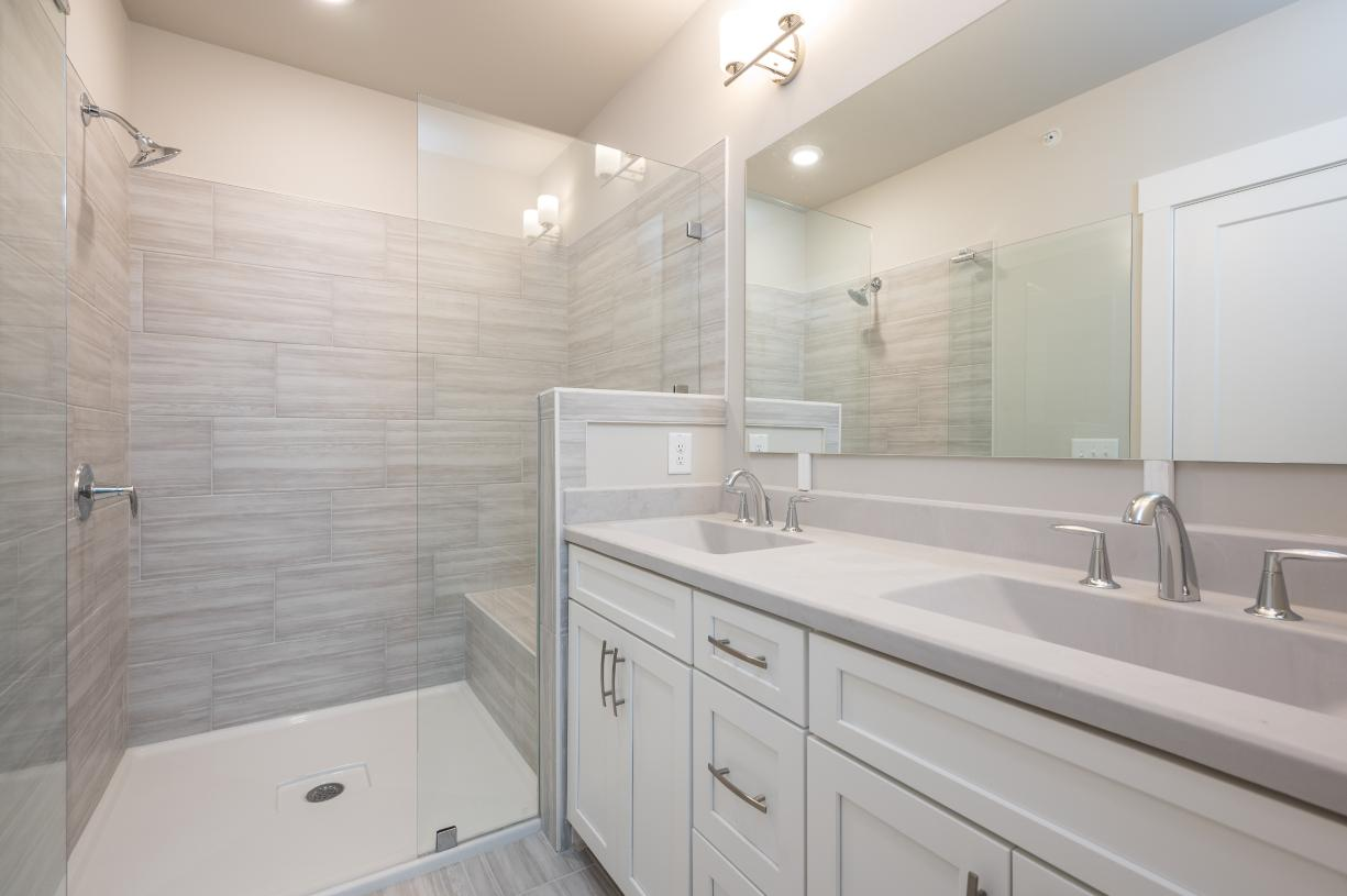 Primary bath with a glass enclosed shower door