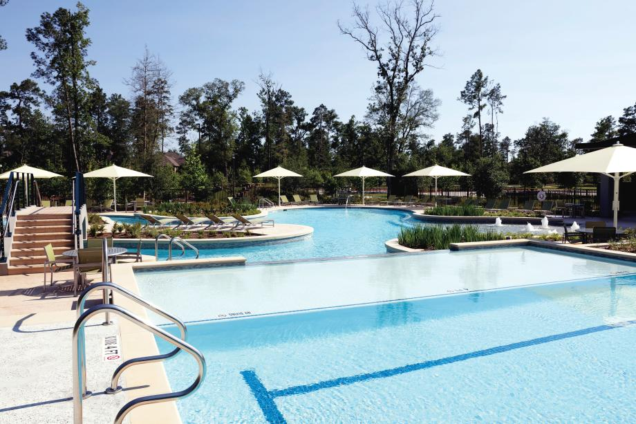 Resort-style pool with expansive deck for sunbathing