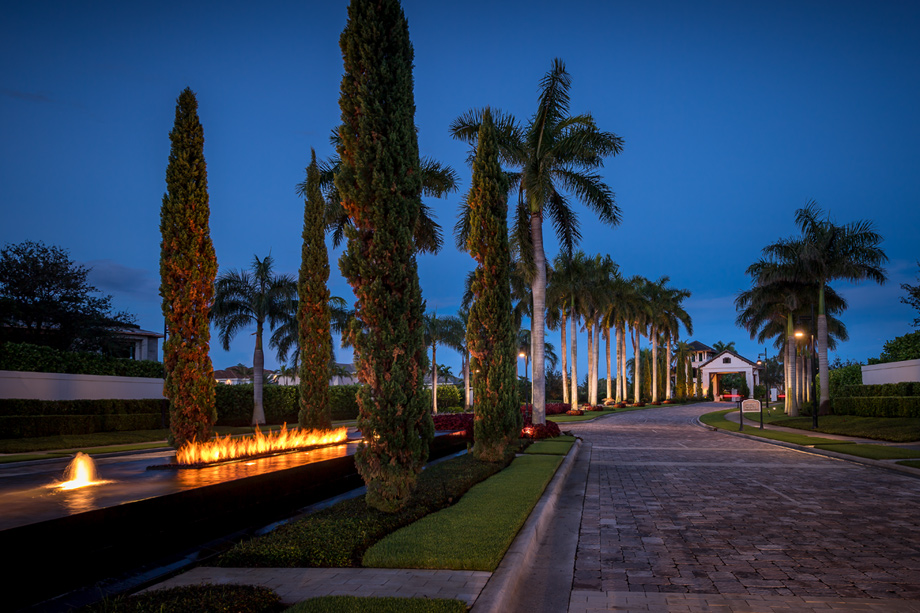 An elegant private drive leads to the community entrance