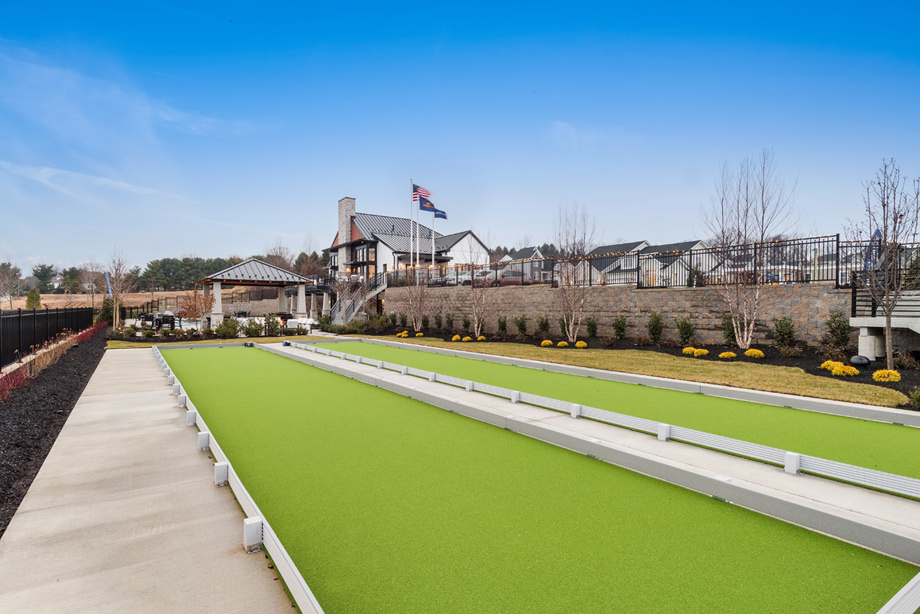 Play bocce ball at the clubhouse court