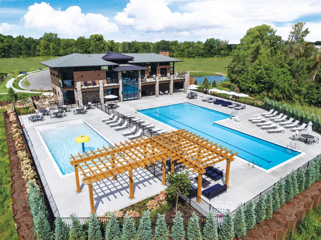 Clubhouse features two outdoor pools and multiple terraces to enjoy