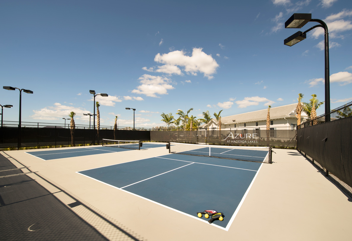 Tennis courts at the Azure at Hacienda Lakes clubhouse