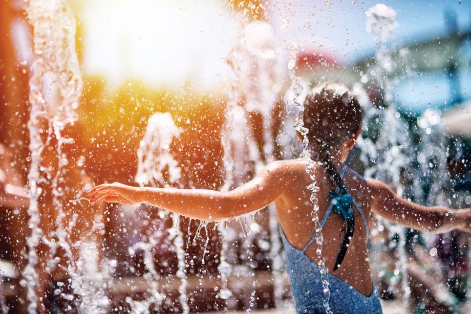 Community pool includes splash zone for summer fun