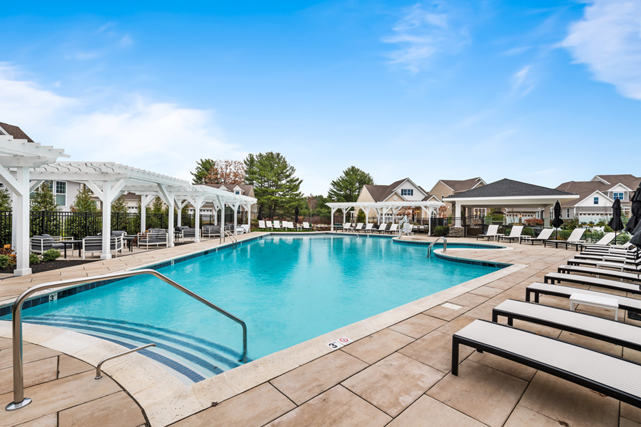 Outdoor heated swimming pool, sundeck, and cabanas