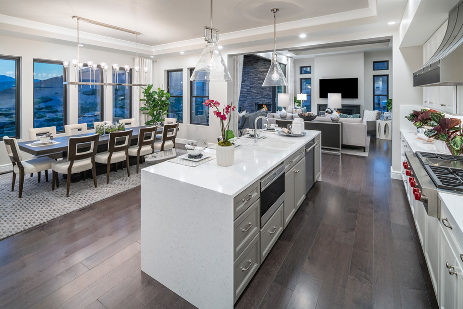 Large kitchen islands with views of the casual dining area and great room beyond