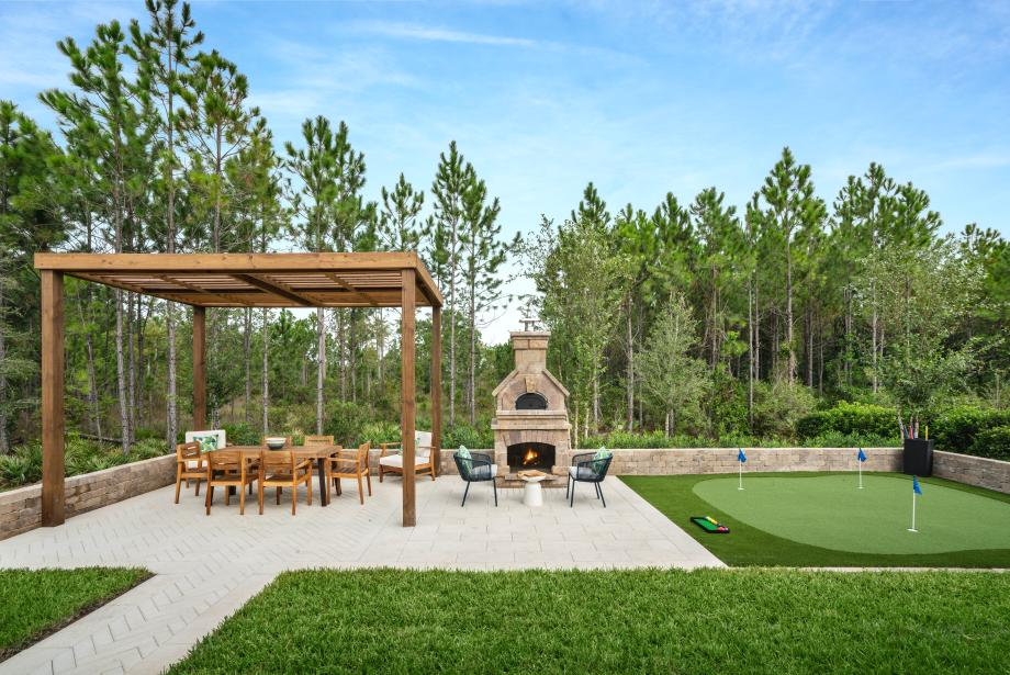 Personalize your backyard space with a pizza oven and covered trellis area