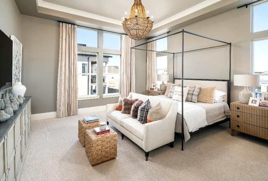 Luxurious primary bedrooms with a seating area