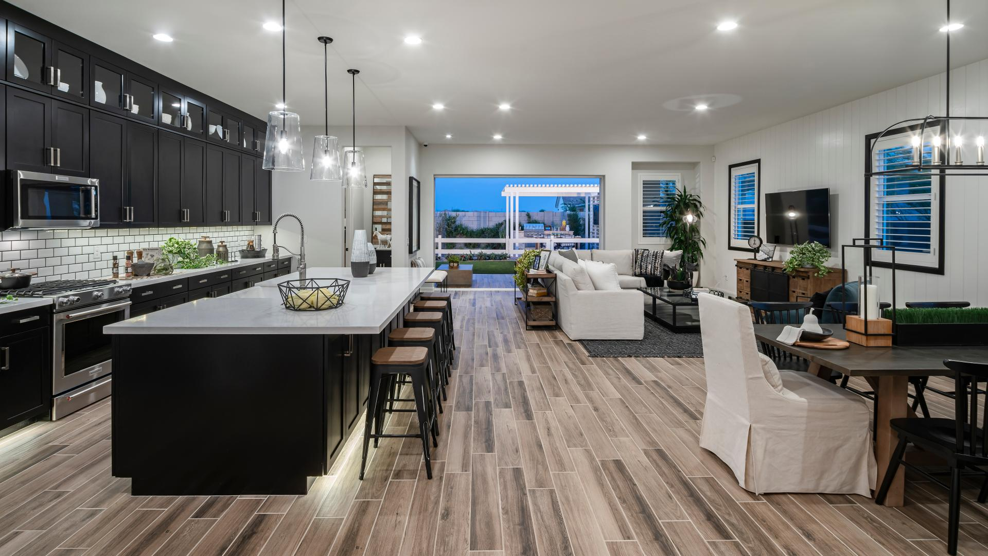 Beautiful kitchens with views of the great room and outdoor living space beyond