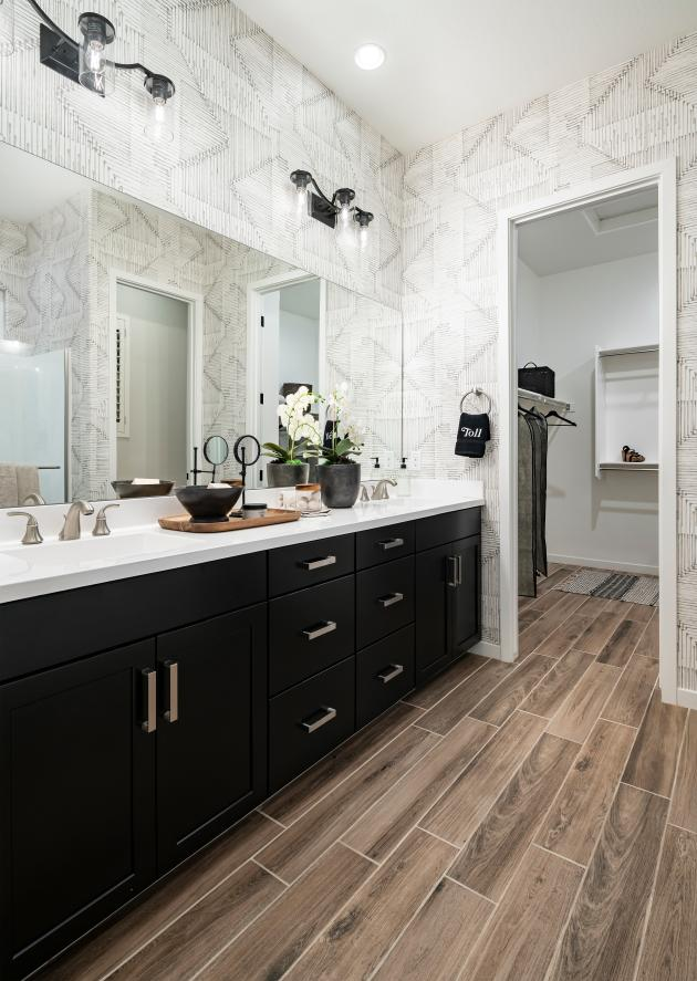 Lavish primary bathrooms with large walk-in closets